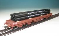 DUHA 11326 D - 6 schwarze Rohre, gebündelt auf Holzträgern (Spur H0)